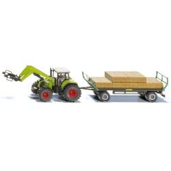 Tracteur Claas avec pince à balles et remorque