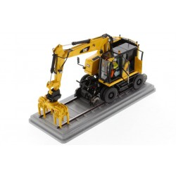 Pelle Caterpillar M323F rail jaune sécurité- Diecast Masters