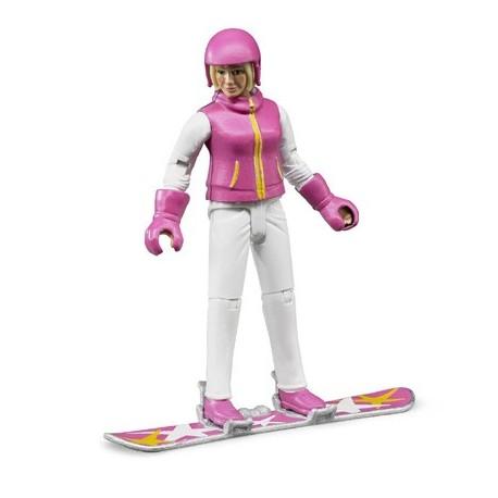 Femme en snowboard avec accessoires