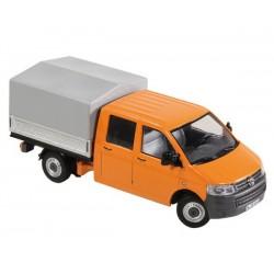 Volkswagen T5 orange avec plateau bâché